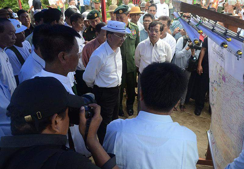 President U Thein Sein hears report on measures taken to prevent flood. Photo: MNA