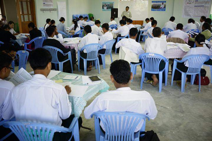 Poll officials study election laws at Ottarathiri District General Administration Office. Photo: Shwe Ye Yint