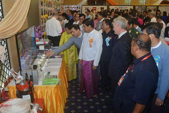 Vice President U Nyan Tun views equipment for prevention of natural disasters.