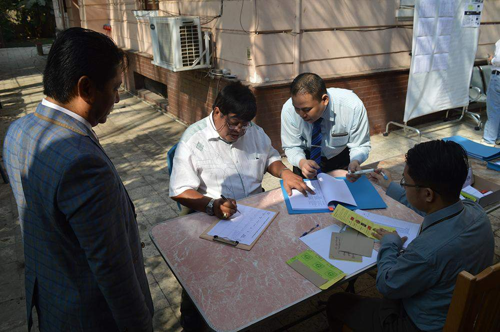Officials check voters' lists before issuing ballot papers to voters at Myanmar's embassy in Cairo, Egypt. Photo: MNA
