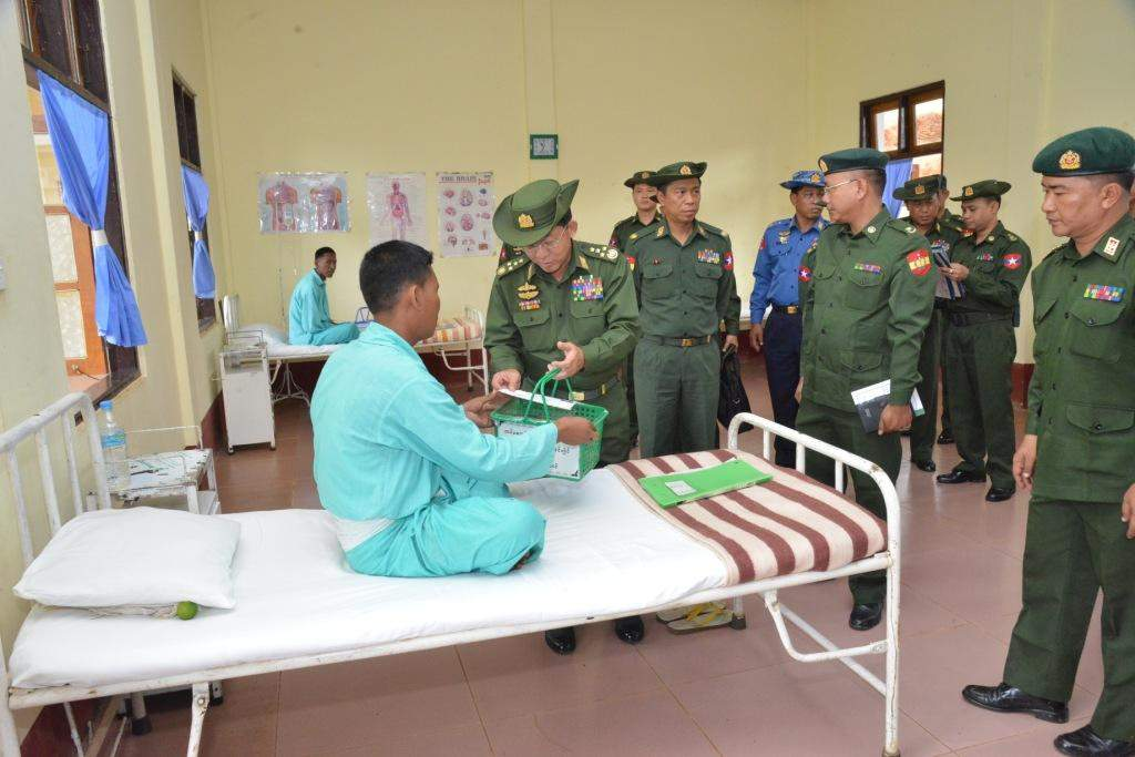 Senior-General Min Aung Hlaing presents a gift to a patient in Hpapon Station.