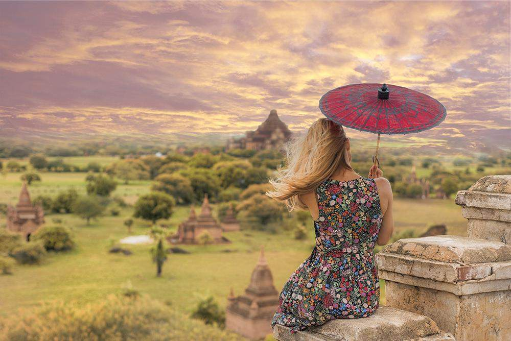 Flymya customer and Turkish travel blogger Hande Cilek enjoys the stunning surrounds of the ancient city of Bagan under the shade of a locally crafted parasol. Photo: Supplied by Hande Cilek