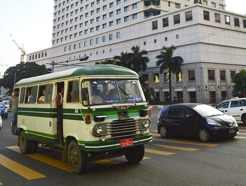One of Yangon's privately operated buses trundles along Sule Pagoda Road.