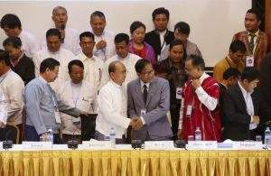 Myanmar President U Thein Sein and Naing Han Tha, a leader of the Nationwide Ceasefire Coordinating Team, shake hands after signing of an earlier draft ceasefire agreement at the Myanmar Peace Centre in Yangon on March 31. Photo: Reuters