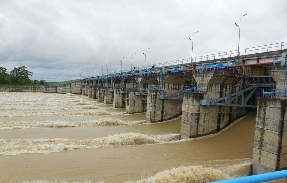 Water flows past spillways of Thaphanseik Dam on 12 October. Photo: Myanmar News Agency