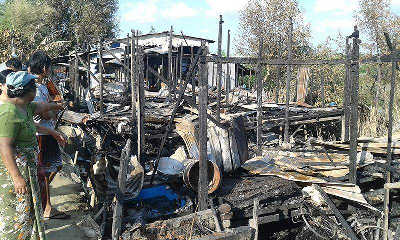 Local people view losses in outbreak of fire in North Okkalapa Township. Photo: Zaw Gyi (Panita)