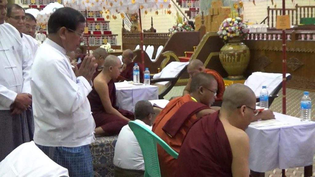 Union Minister U Soe Win pays homage to monks sitting for Tipitakadhara Tipitakakovida examination. Photo: MNA