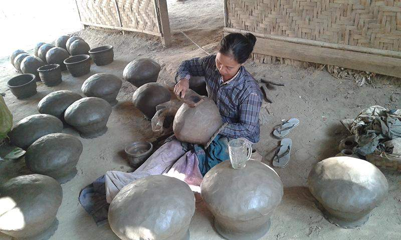 A woman is crafting a clay pot at a pottery in Myinmu Township. Photo: 246/Kyemon