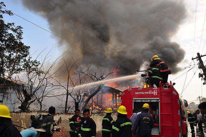 Firefighters putting out the fire. Photo: Aung Thant Khaing
