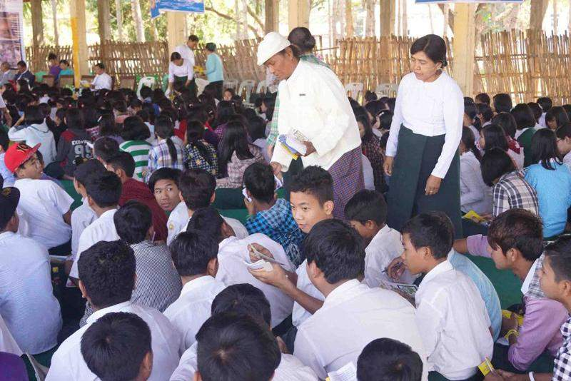 Officials delivering educative pamphlets to the attendees. Photo: Shwe Win (017)