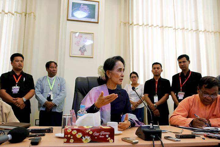 National League for Democracy leader Daw Aung San Suu Kyi talks to journalists during her meeting with the media in her office at the parliament in Naypyitaw, February 3, 2016.