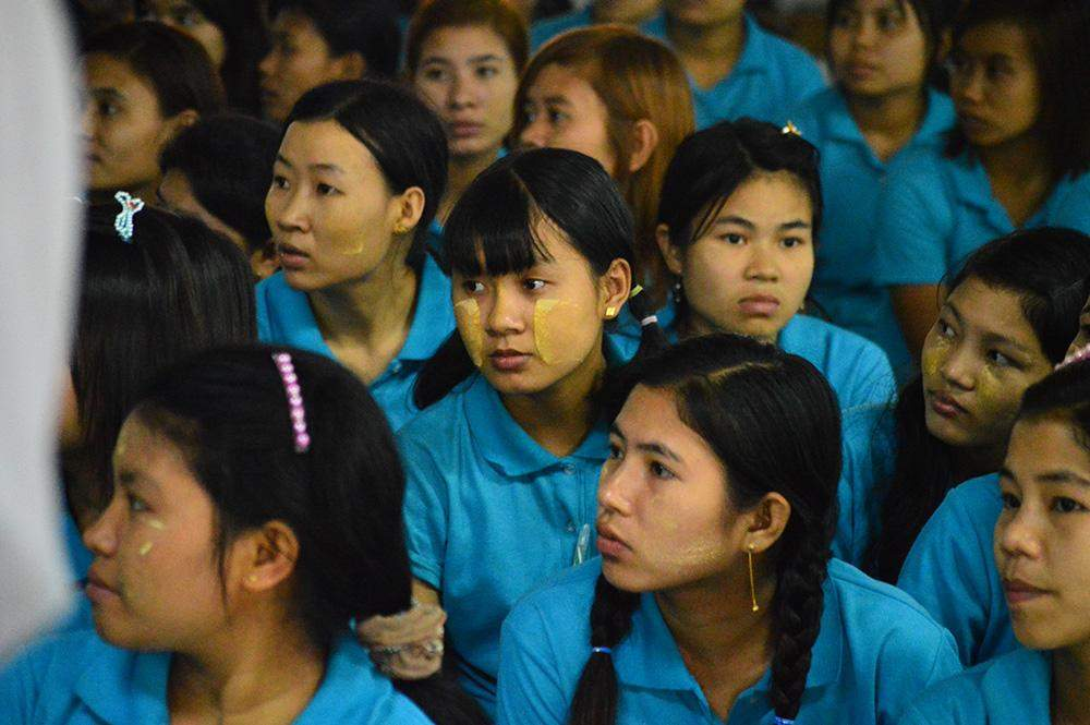 Workers from a garment factory garther during an assembly of their factory. Photo: Aye Min Soe