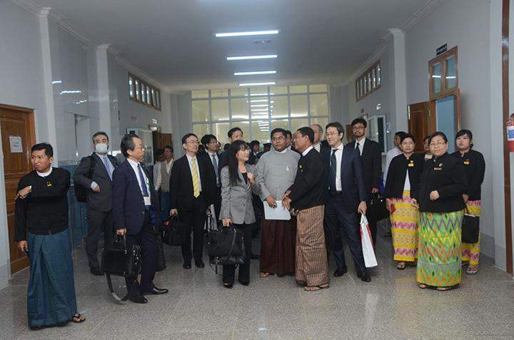 Officials conduct Japanese delegation around Yangon East District Court.
