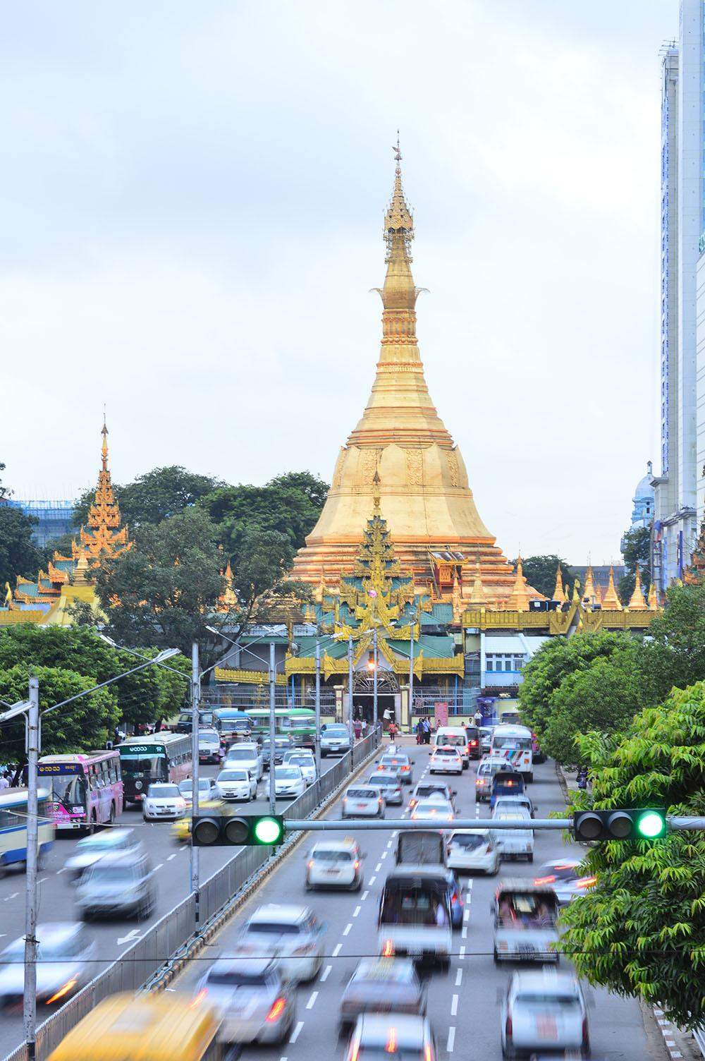 Bus stops at downtown Yangon are crowded with people during rush hours. Photo: Aye Min Soe
