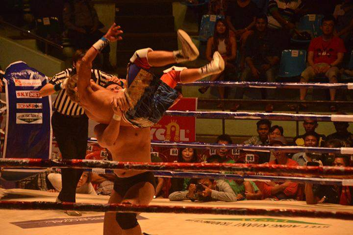 Two wrestlers competes in first WWE-like wrestling in Yangon.