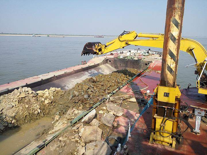 Sandstones being dredged and removed  from the floor of the Ayeyawady River.