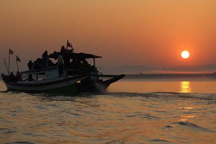 A ship churns the Ayeyawady at dusk, Bagan.