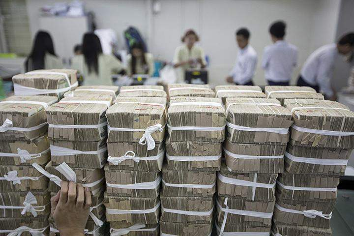 Stacks of Myanmar Kyat are prepared at a bank ahead of being transported in Yangon.