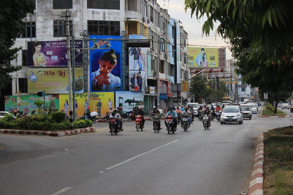 Motorcyclists are seen in Mandalay . Photo: Myitmakah News Agency