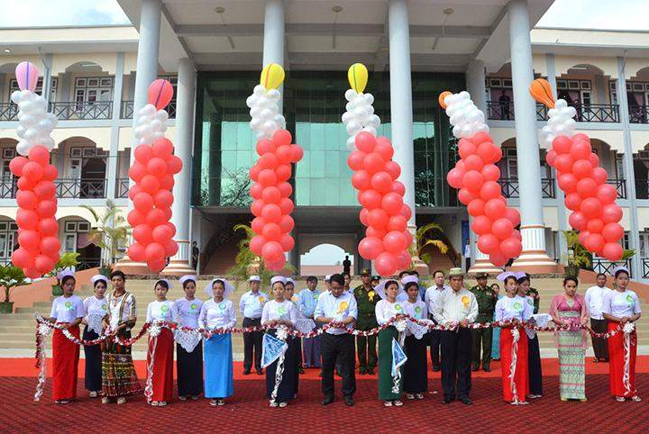 Dignitaries seen formally opening the training school for nursing and midwifery in the presence of President U Thein Sein.
