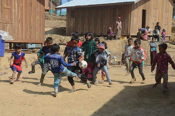 Children from families relocated to new homes are playing.