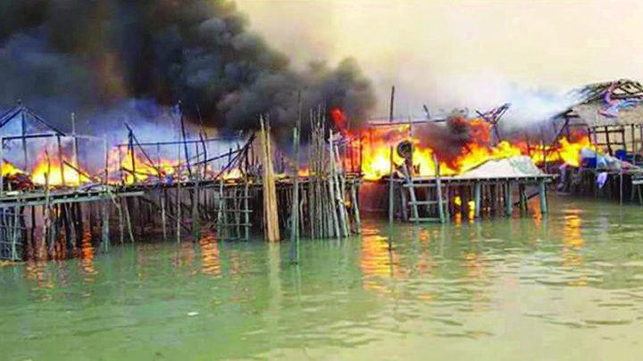 Massive fire engulfs the houses.