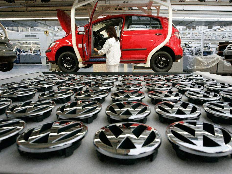 Workers assemble a Volkswagen Golf Plus in the production line in Wolfsburg, Germany.