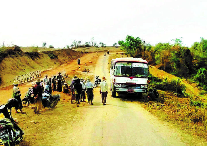 Bus seen after colliding an ox cart.
