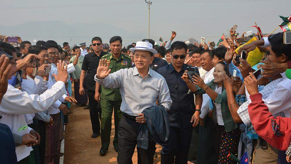 President U Thein Sein waves hands to residents on his tour of Madaya, Mandalay Region. Photo: MNA
