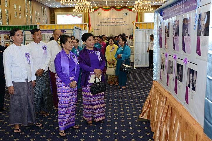 Union ministers visit booth displaying documentary photos.