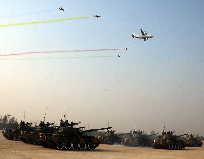 Armoured vehicles rolling into the parade ground where 71st Anniversary Armed Forces Day is being held while planes of the Tatmadaw are flying over the parade. Photo: MNA