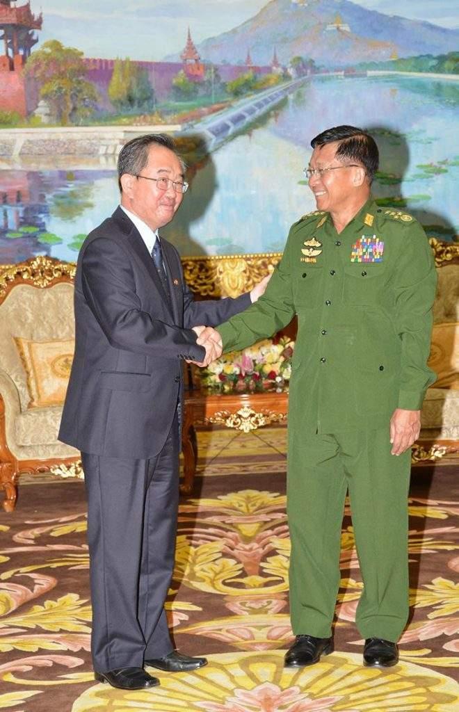 Senior General Min Aung Hlaing shakes hands with Ambassador Mr Kim Sok Chol.