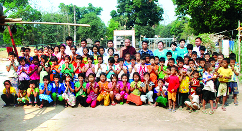 Orphans pose for a group photo section. Photo: Ko Lwin (Swa)