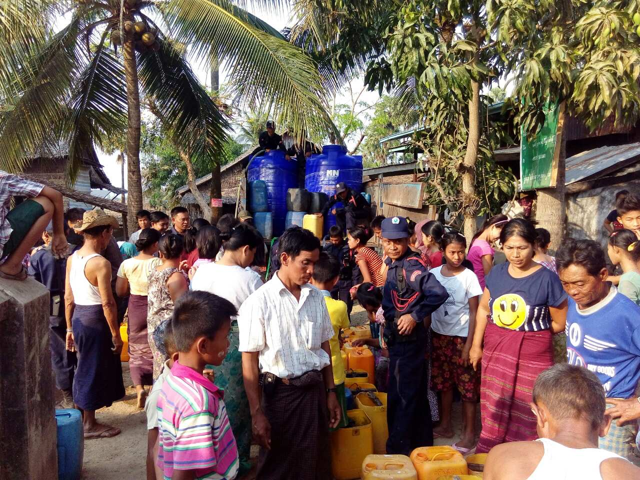Residents in Thaton collect drinking water from donors. Photo: Myitmakha news Agency