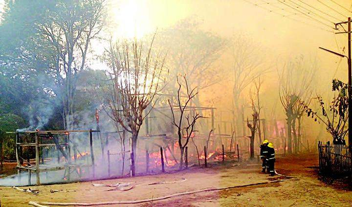 Somke billows from burning houses.