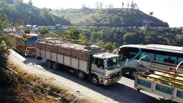 Trucks loaded with goods are seen en-route to China.
