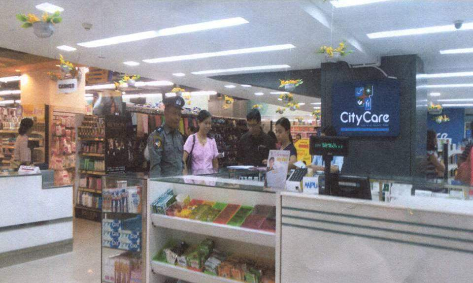Authorities inspecting a pharmaceutical store of it is sell the forbidden drugs.