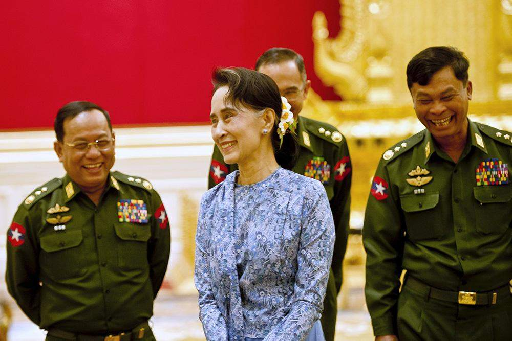 Daw Aung San Suu Kyi smiles with army members during the handover ceremony of Presidency in Nay Pyi Taw on 30 March. Photo: Reuters