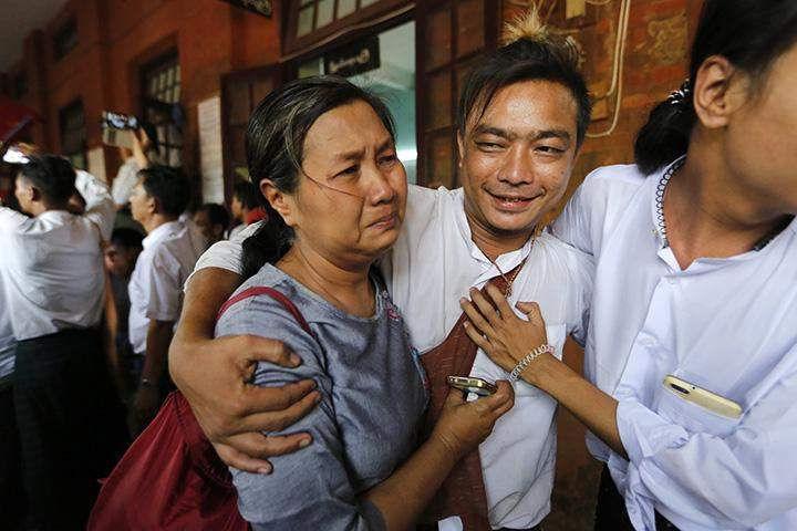 A student protester (C) and his family member cry after he was released by the new government's general amnesty at Thayawady court, Thayawady, Bago division on 8 April 2016.