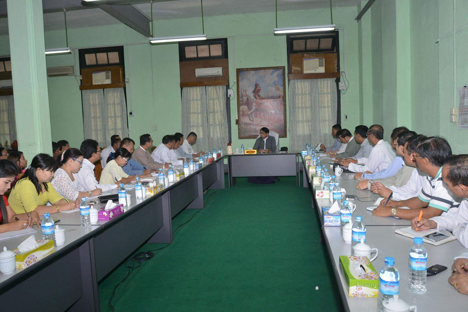Union Minister for Information Dr U Pe Myint meets officials from departments and enterprises of the ministry in Yangon. Photo: MNA