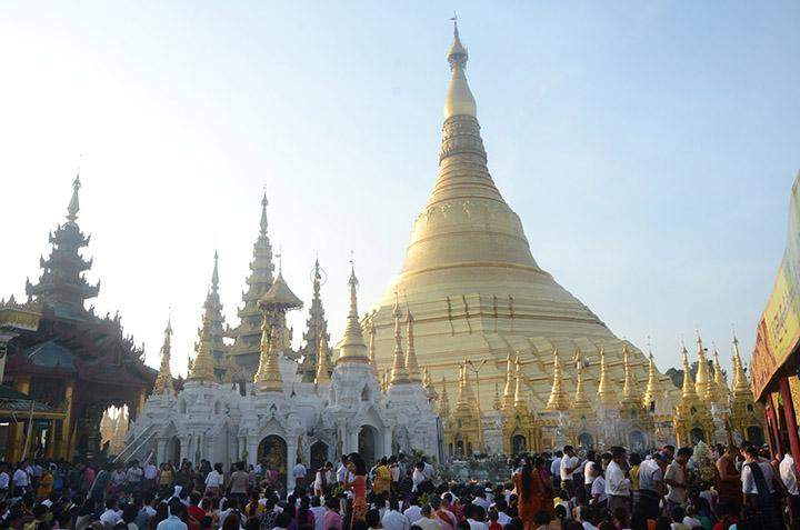 Devotees visit the Shwedagon Pagoda on the New Year Day.