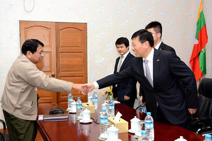 Union Minister for Information Dr Pe Myint receiving the Chinese Ambassador Mr. Hong Liang at his office in Nay Pyi Taw.