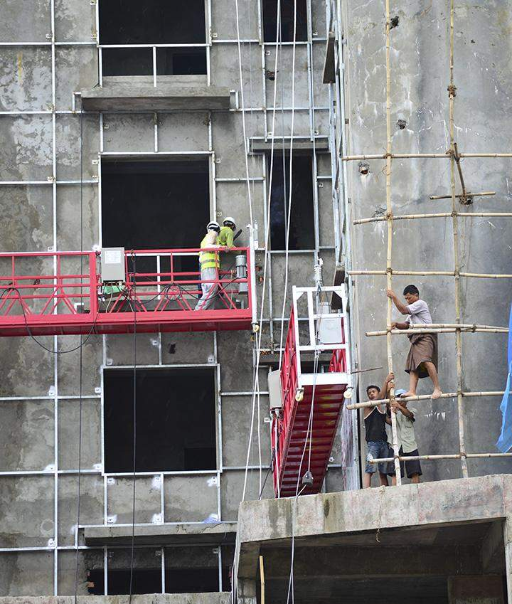 Workers are seen at a construction site in Yangon.