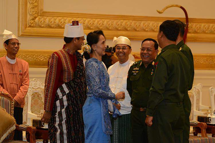 Daw Aung San Suu Kyi smiles with army Union ministers appointed by army the handover ceremony of presidency in Nay Pyi Taw.