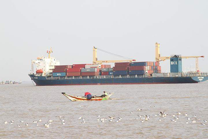 An ocean liner carrying containers is seen in the Yangon River.