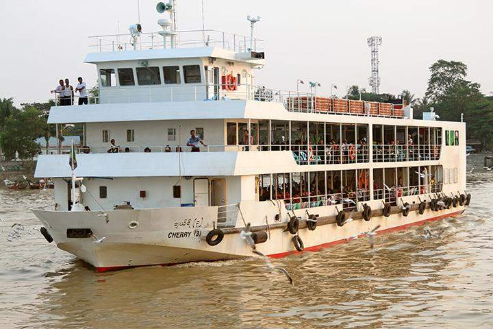"A ferry called ""Cherry (3)"" shuttles in the Yangon River."