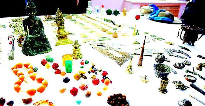 Gems and jewelery are seen at an emporium.