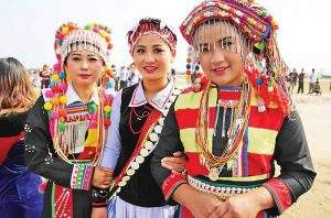 Three Lisu women wear traditional dress.