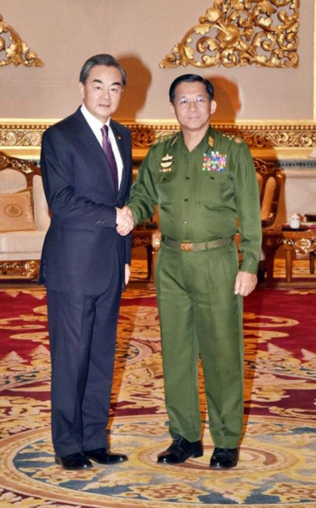 Senior General Min Aung Hlaing shakes hands with Chinese Foreign Minister Mr. Wang Yi.