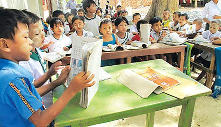 Myingyan Degree College students and faculty provide literacy services to rural children.